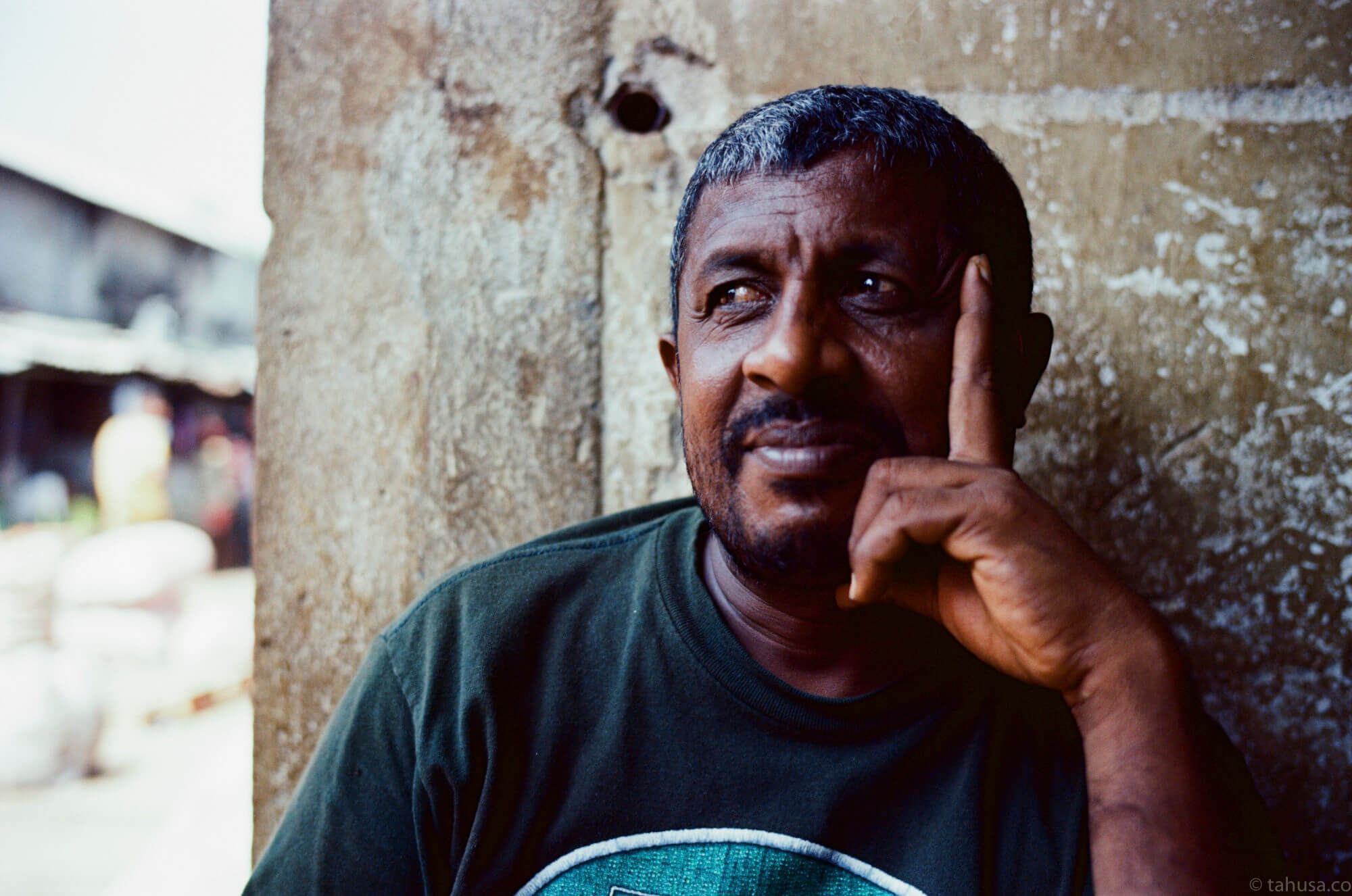 smiling-man-letting-me-to-take-portrait-for-him-in-pettah-market-colombo-sri-lanka-travel-photography-using-ektar-100-kodak-and-summilux-35mm-f1.4-asph-fle-leica-film