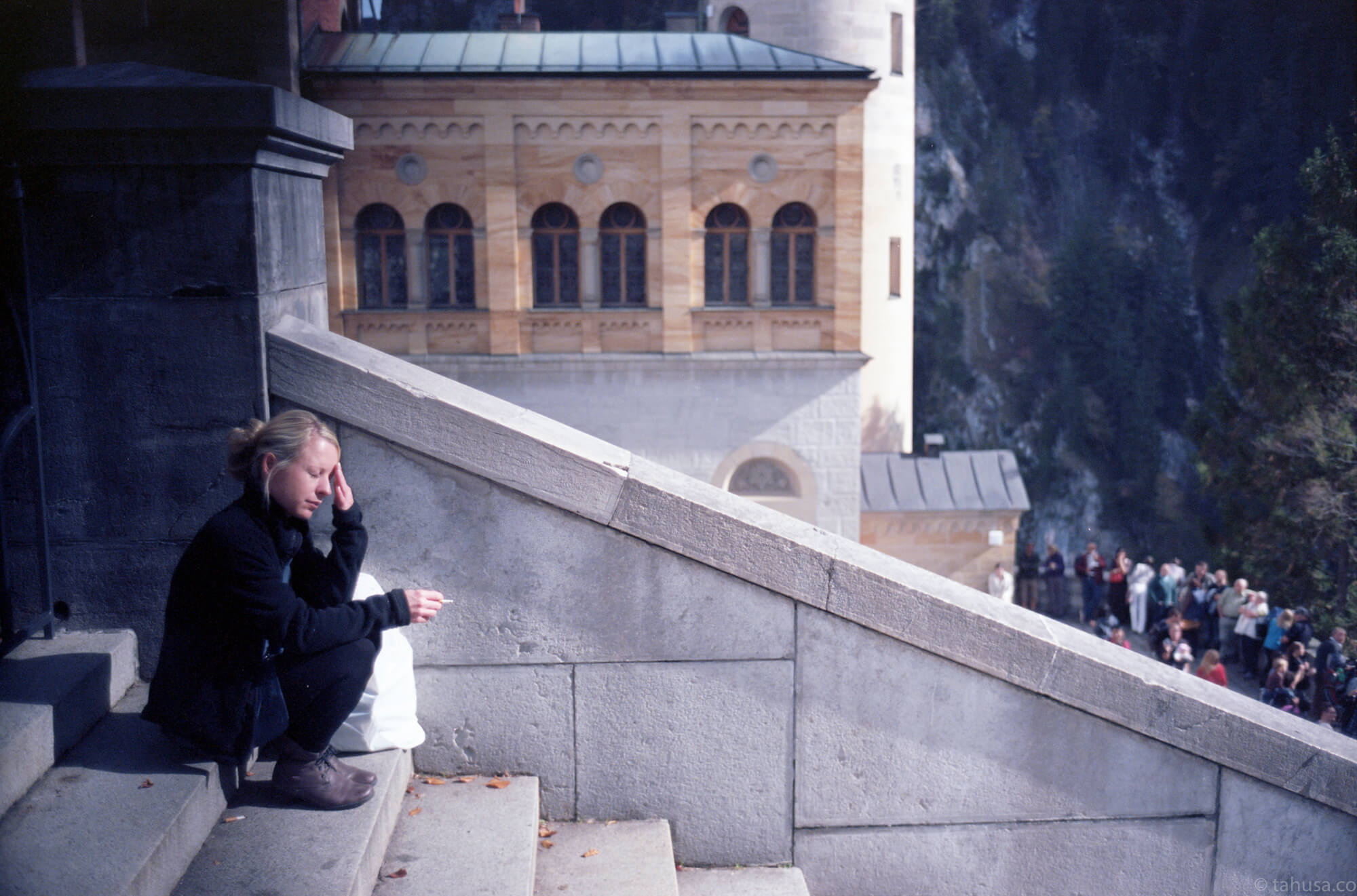 A-girl-with-cigarette-resting-in-Neuschwanstein-Castle-füssen-Germany-travel-photography-using-ektar-100-kodak-and-summicron-35mm-f2-8elements-v1-leica-film