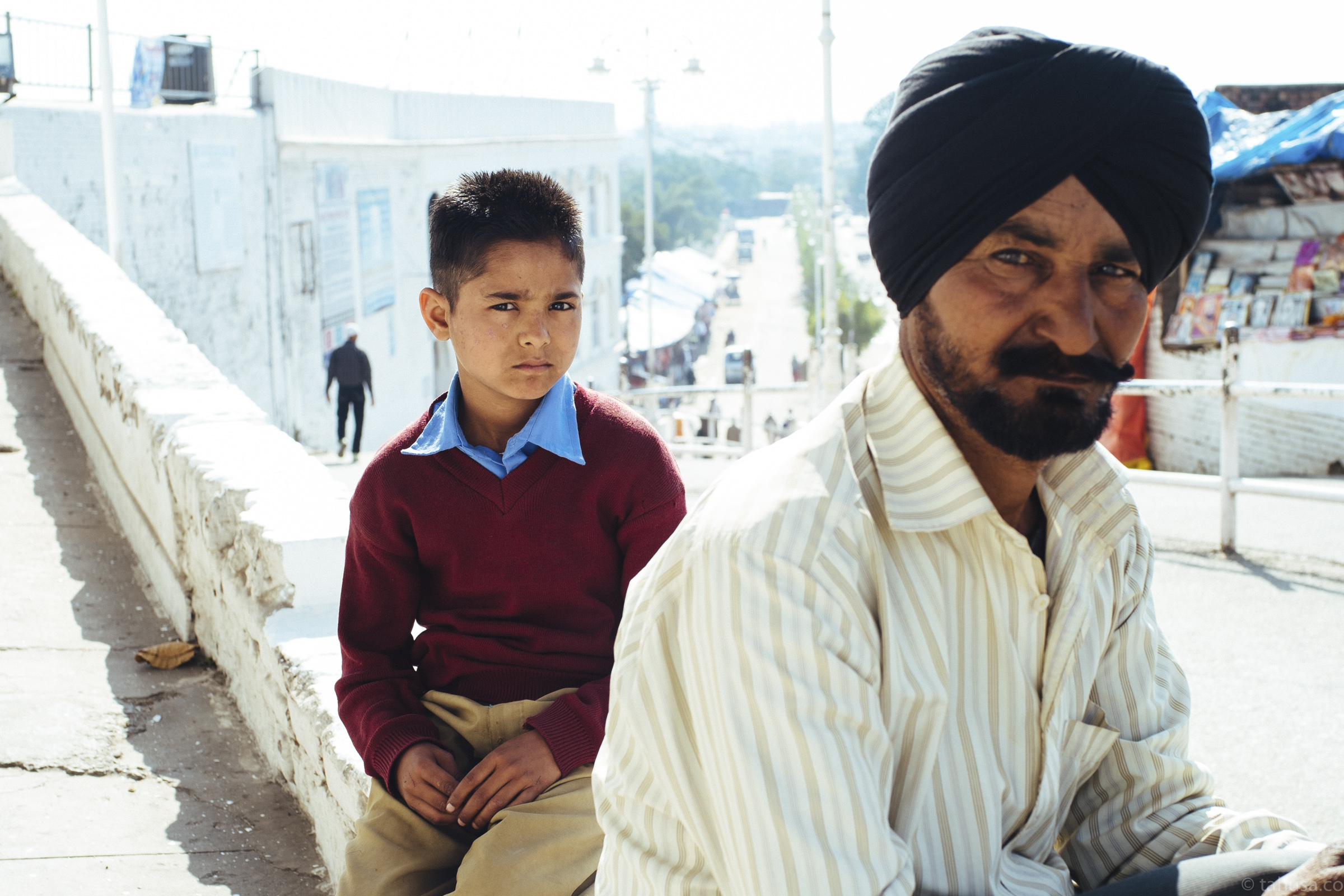 father-and-son-posing-outside-temple-in-Una-India-fuji-fujifilm-xe1-35mm-portrait-city-scanner-cities-snap