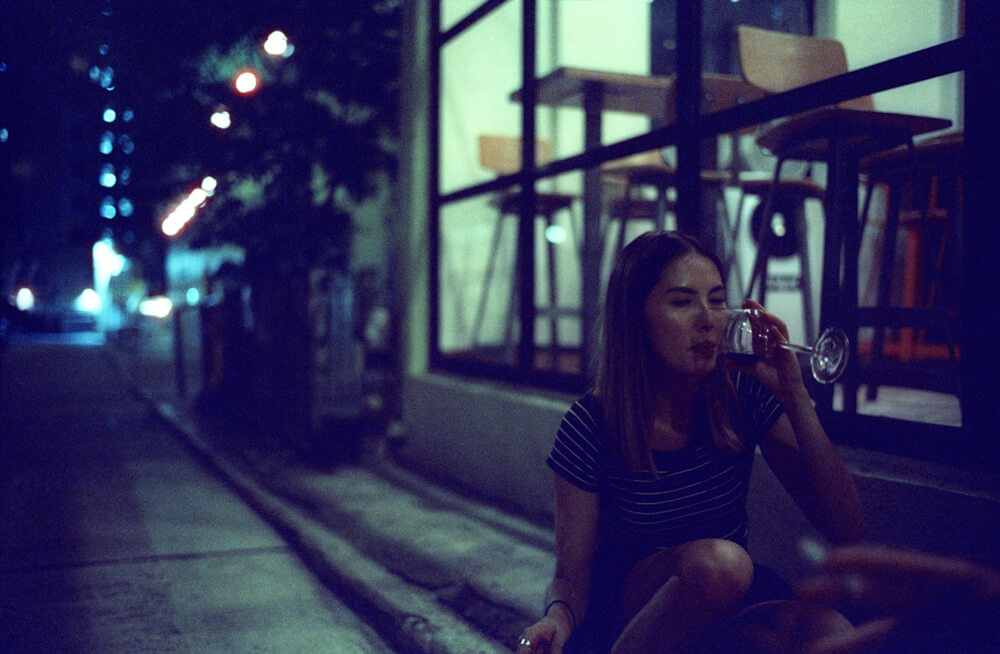 Fay-portrait of drinking wine-Hong Kong-LKF-Lan Kwai Fong-Dinner Time-Meet up-CineStill 800T-Tungsten-Summilux 35mm-Leica-Night-Neon light-HK-Portrait