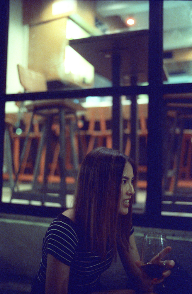 Fay-portrait of drinking wine-Hong Kong-LKF-Lan Kwai Fong-Dinner Time-Meet up-CineStill 800T-Tungsten-Summilux 35mm-Leica-Night-Neon light-HK-Portrait.jpg