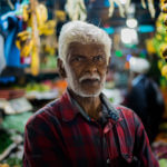 Handsome-old-man-store-owner-banana-Nuwara-Eliya-Street-snap-portrait-local-food-market