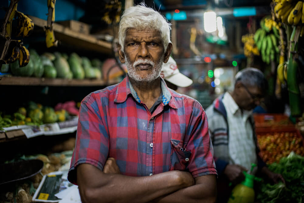 Handsome-old-man-store-owner-banana-Nuwara-Eliya-Street-snap-portrait-local-food-market 2