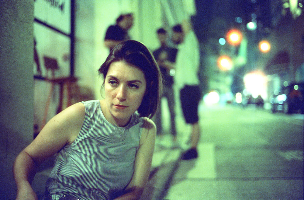 Laura-smoking outside restaurant-Hong Kong-LKF-Lan Kwai Fong-Dinner Time-Meet up-CineStill 800T-Tungsten-Noctilux-50mm-Leica-Night-Neon light-HK-Portrait-wine drinking-film 135
