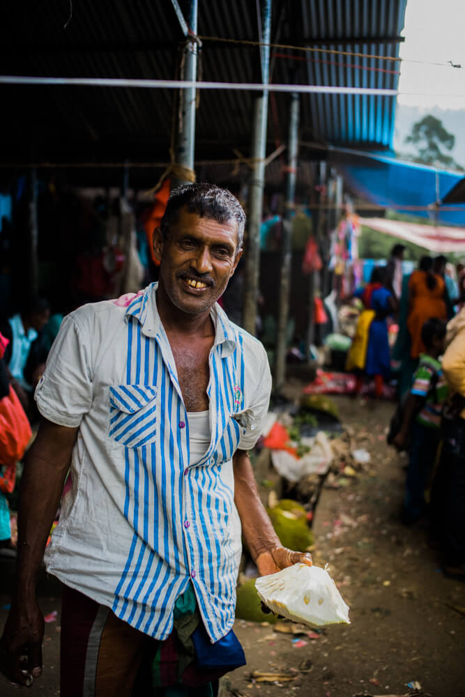 Local-sunday-market-seller-smiling-to-me-grocery-in-Nuwara-Eliya-Sri-Lanka 2