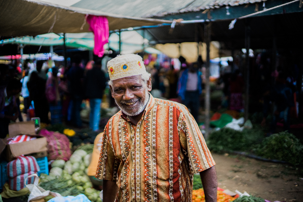 Local-sunday-market-seller-smiling-to-me-grocery-in-Nuwara-Eliya-Sri-Lanka