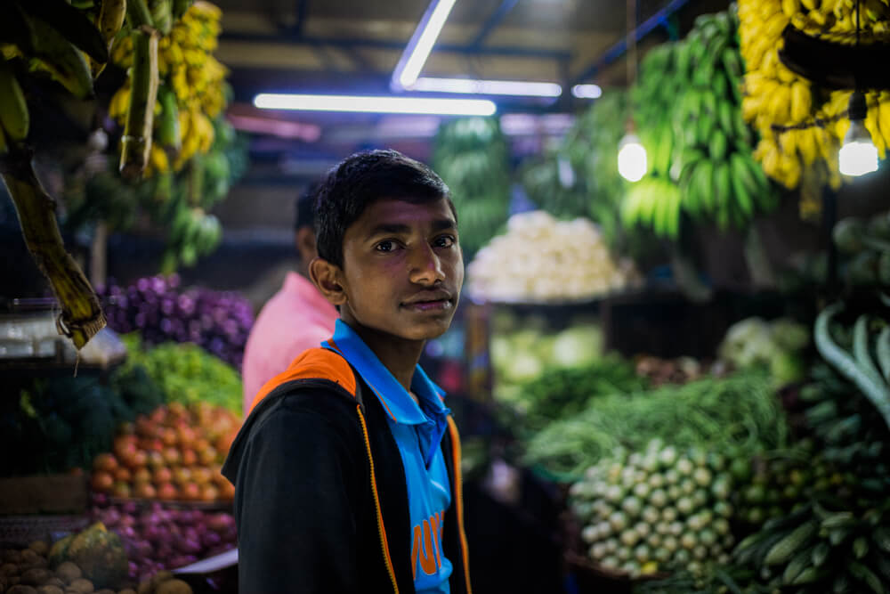 Store-seller-Local-food-market-Nuwara-Eliya-Portrait-for-him-bokeh-Summilux-35mm-FLE-travel