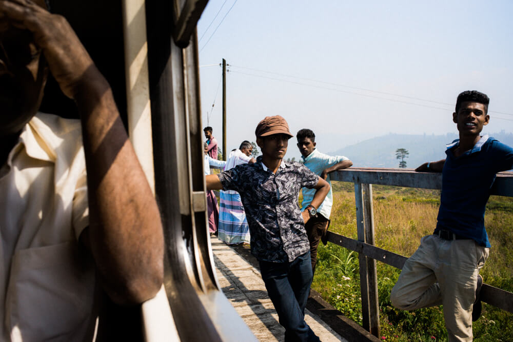 Train-to-Nuwara-Eliya-Sri-Lanka-Local-People-Posing-outside-Train-stop-sunny-day