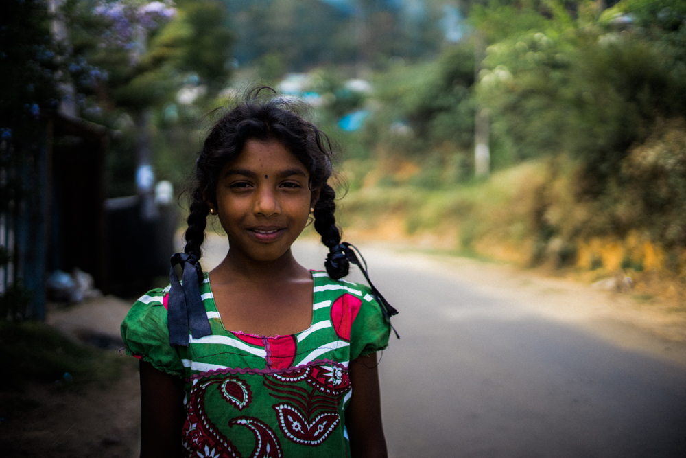 portrait-taken-while-walking-back-to-hostel-smiling-girl-Nuwara-Eliya-Sri-Lanka