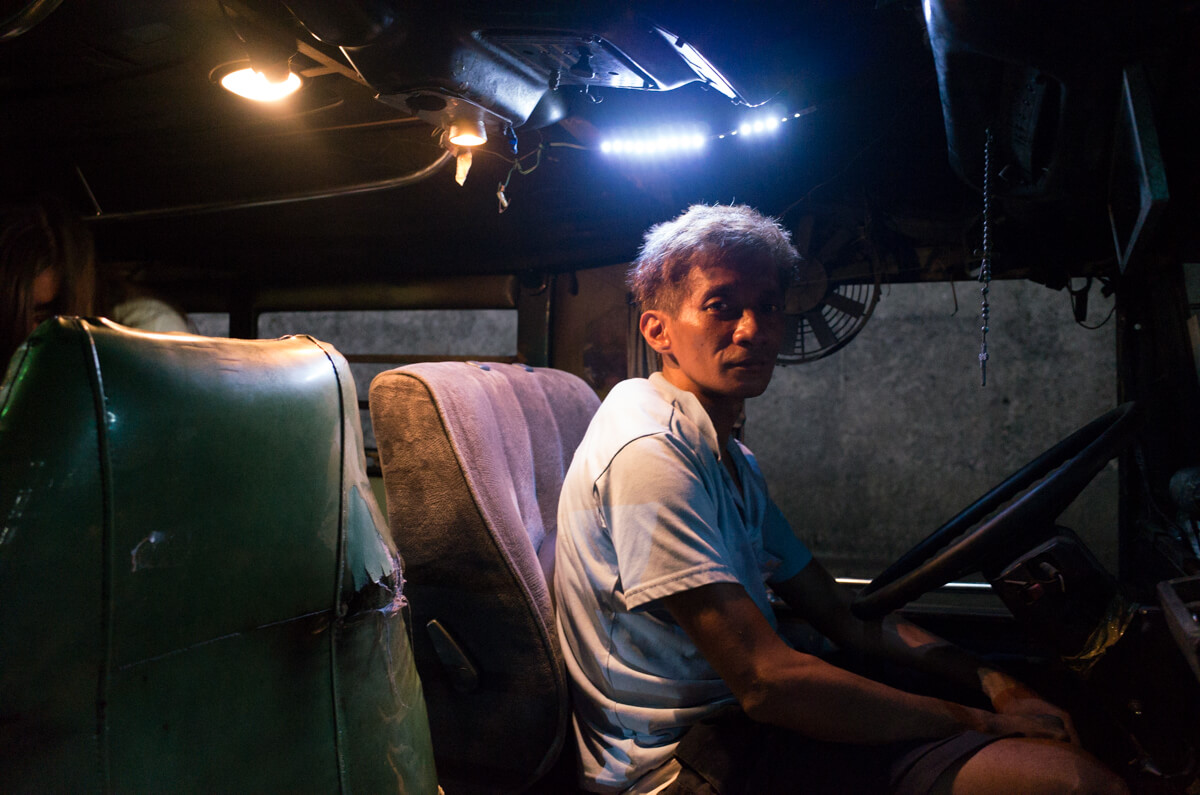 Another-portrait-for-driver-Manila-Philippines-Travel-street-snap-night-photography-signature-jeepney-jeep-car-iconic-vehicle-dercorated-bus-Ricoh-GR-digital-camera