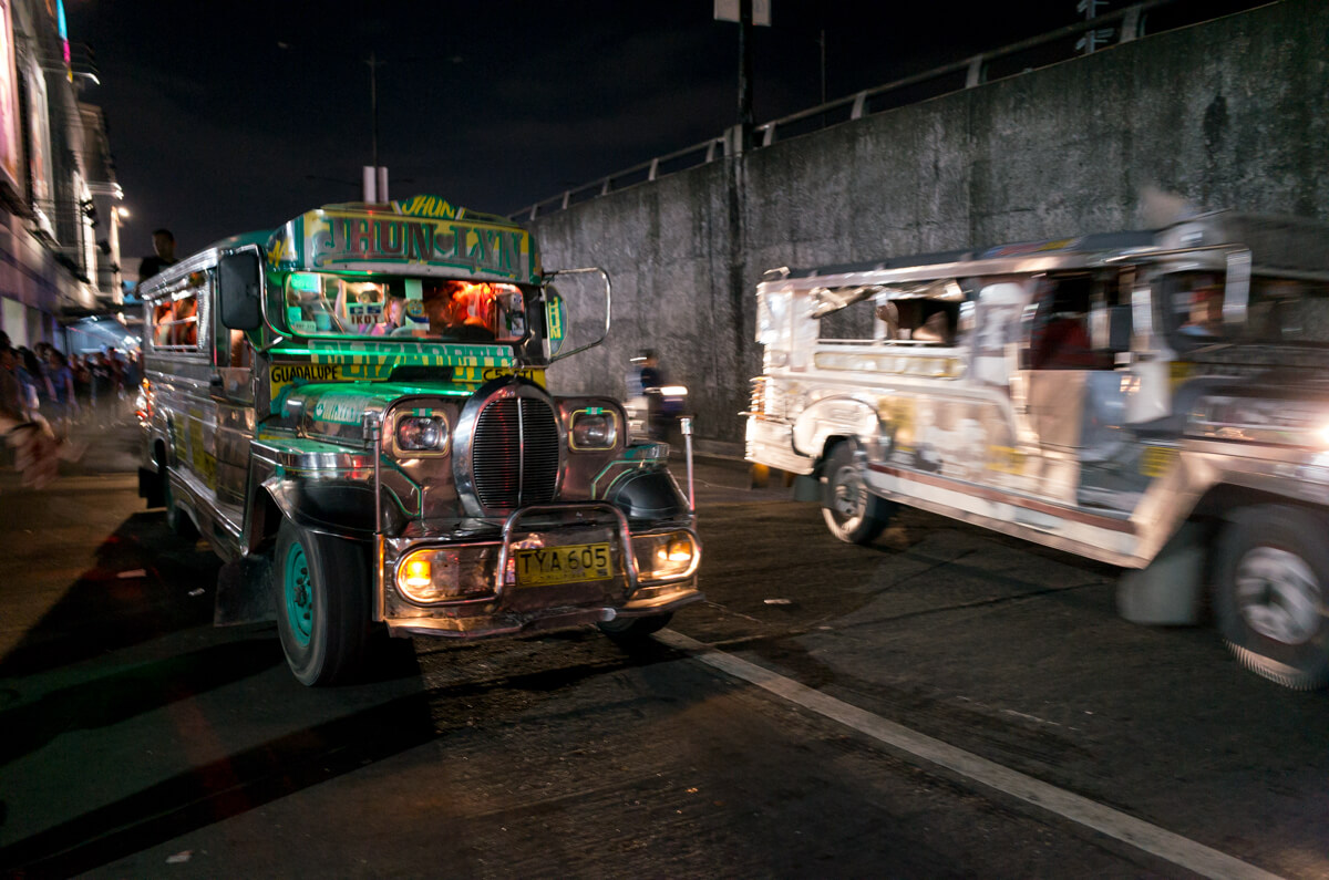 Cars-everywhere-in-all-directions-busy-condense-Manila-Philippines-Travel-street-snap-night-photography-signature-jeepney-jeep-car-iconic-vehicle-dercorated-bus-Ricoh-GR-digital-camera