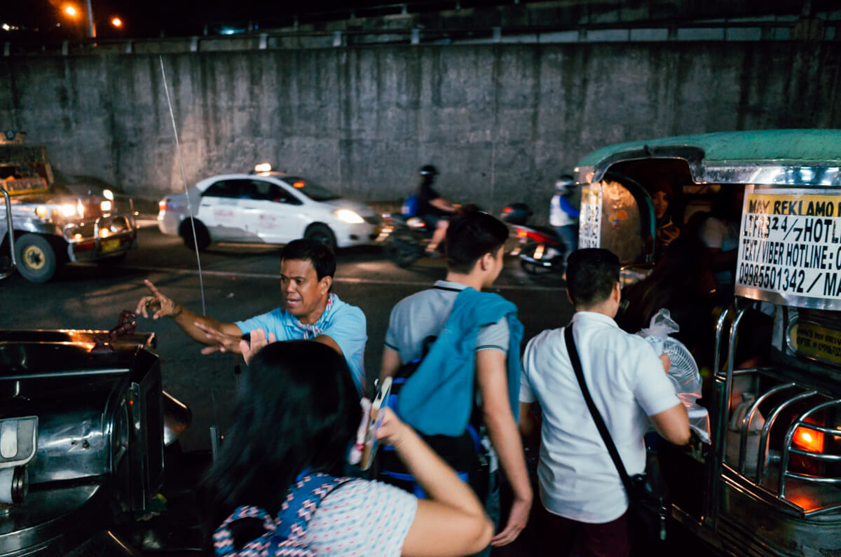 People-queing-to-get-into-vehicle-communting-Manila-Philippines-Travel-street-snap-night-photography-signature-jeepney-jeep-car-iconic-vehicle-dercorated-bus-Ricoh-GR-digital-camera