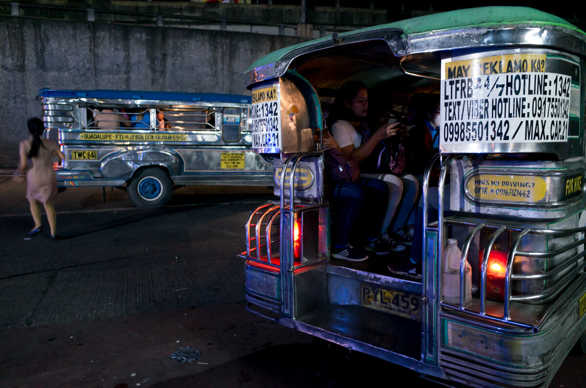 back-of-the-jeep-bus-Manila-Philippines-Travel-street-snap-night-photography-signature-jeepney-jeep-car-iconic-vehicle-dercorated-bus-Ricoh-GR-digital-camera