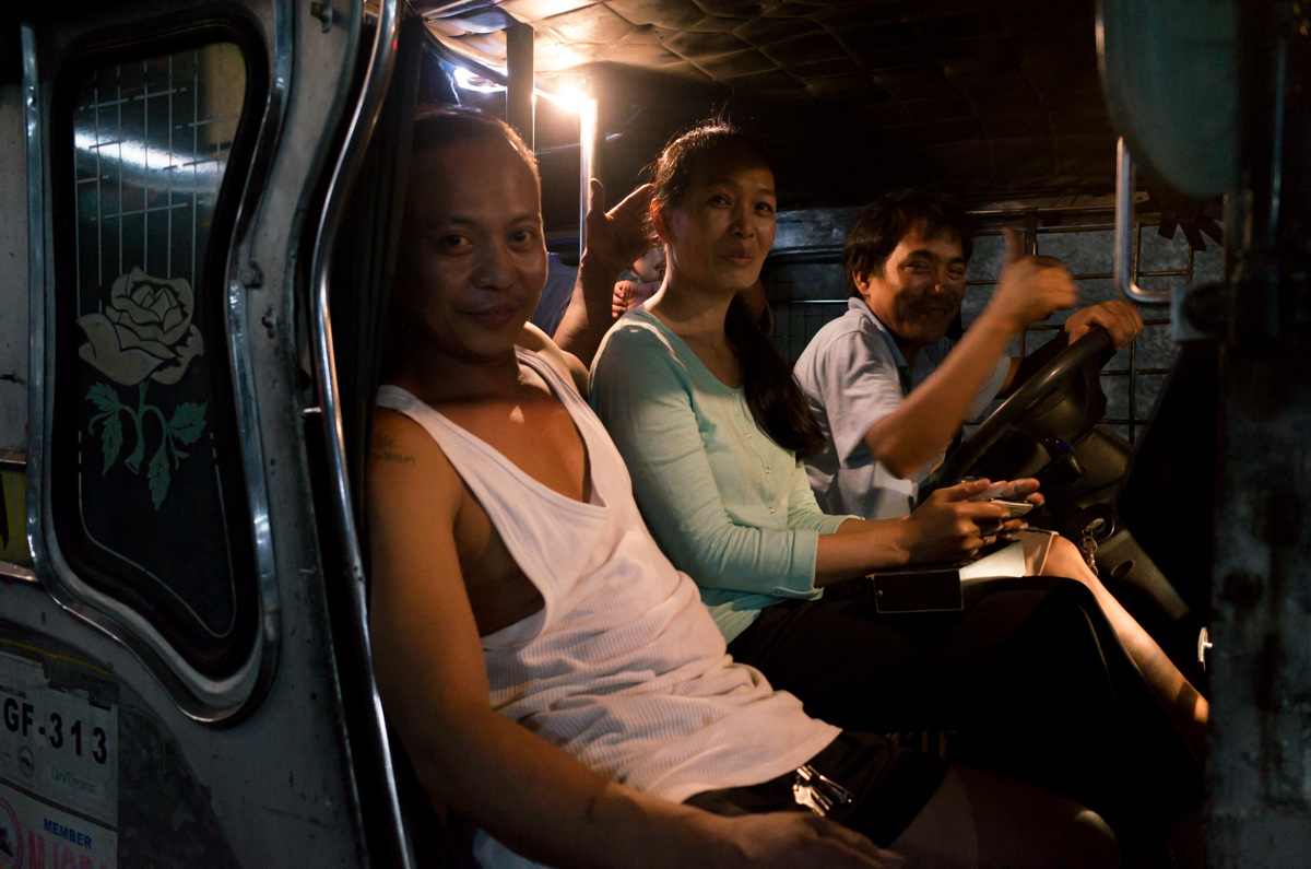 driver-and-other-passengers-setting-together-front-seat-city-busy-Manila-Philippines-Travel-street-snap-night-photography-signature-jeepney-jeep-car-iconic-vehicle-dercorated-bus-Ricoh-GR-digital-camera