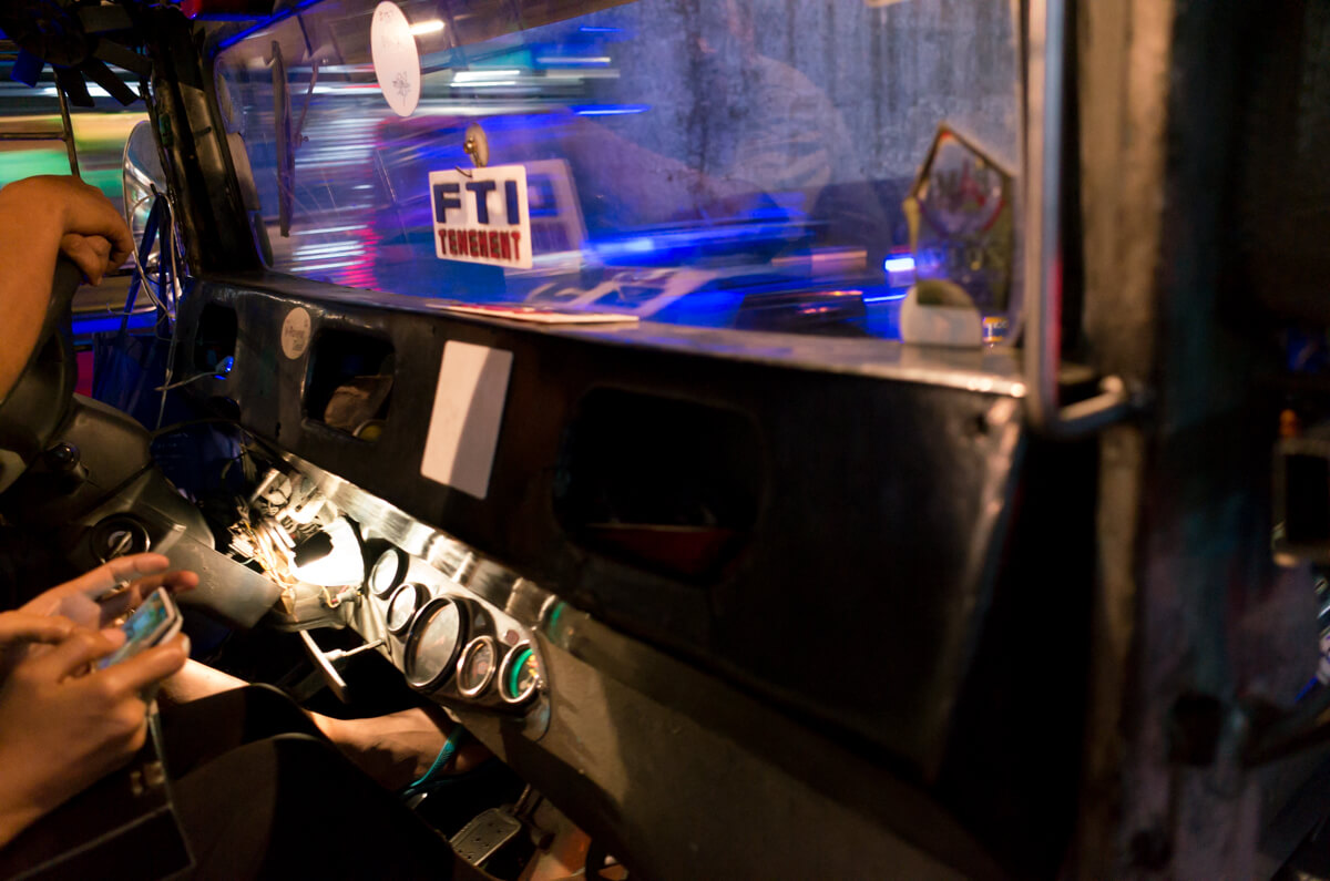 interrior-of-the-car-busy-city-Manila-Philippines-Travel-street-snap-night-photography-signature-jeepney-jeep-car-iconic-vehicle-dercorated-bus-Ricoh-GR-digital-camera