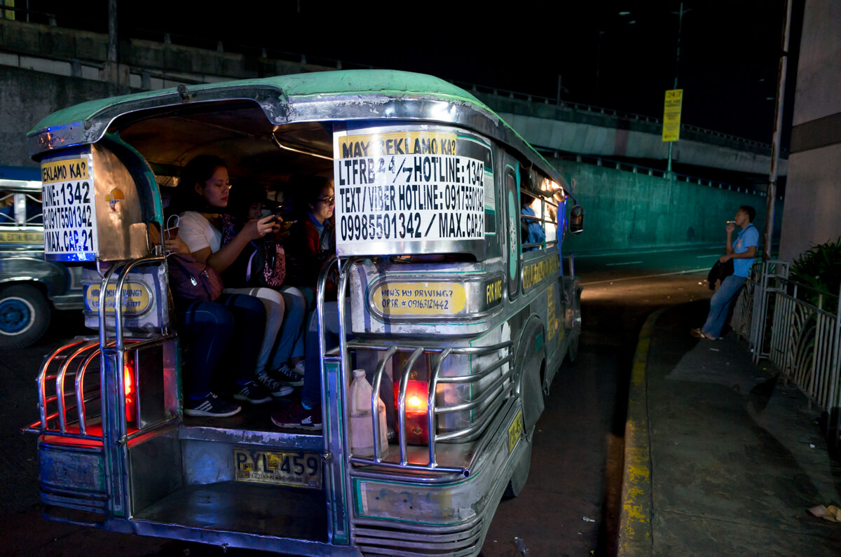 they-are-seated-and-waiting-to-depart-city-Manila-Philippines-Travel-street-snap-night-photography-signature-jeepney-jeep-car-iconic-vehicle-dercorated-bus-Ricoh-GR-digital-camera