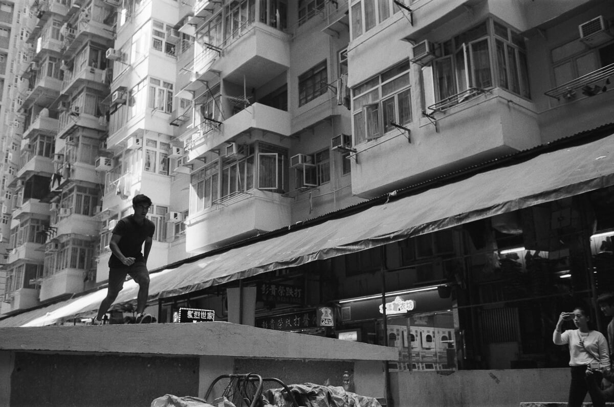Arjun-running-Quarry-Bay-hong-kong-shutter-alliance-photowalk-Leica-Summicron-35mm-f2-IV-Ilford-Delta-400-black-and-white-bw-monotone