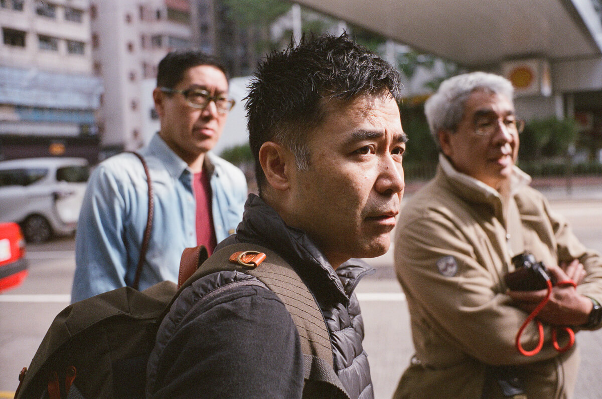 Bigheadtaco-take-kayo-during-our-photowalk-photo-walk-visiting-hong-kong-HK-shutteralliance-shutter-alliance-central-fuji-fujifilm-pro400H-negative-film-community-leica-summicron-35mm-f2-v1-lens-2-waiting-to-go-yik-cheong-building