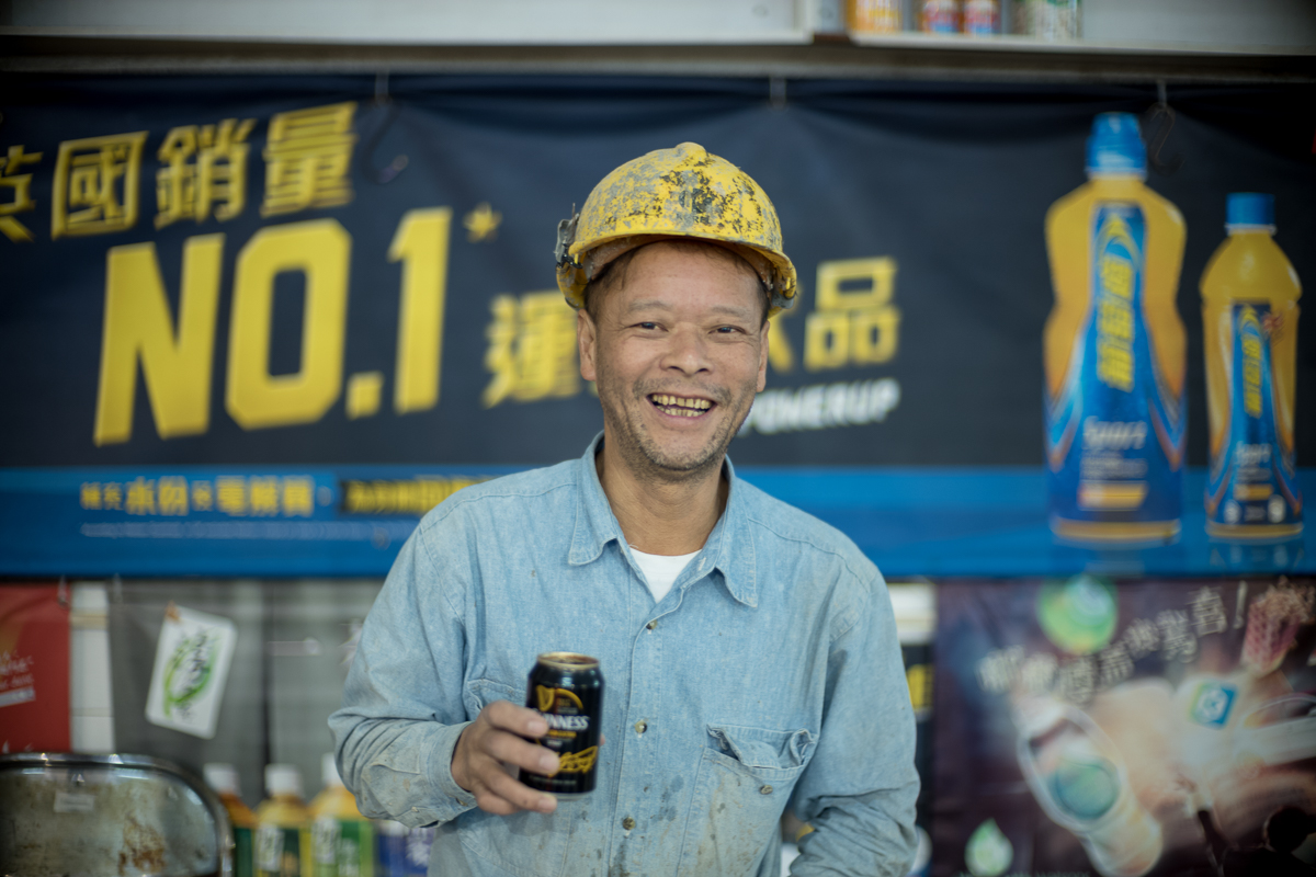 Happy-construction-worker-drinking-beer-inside-pier-and-let-me-take-portrait-for-him-Hong-Kong-Shutter-Alliance-Photowalk-photo-walk-hk-North-Point-Leica-m10-digital-camera-rangefinder-Noctilux-50mm-f1-e58