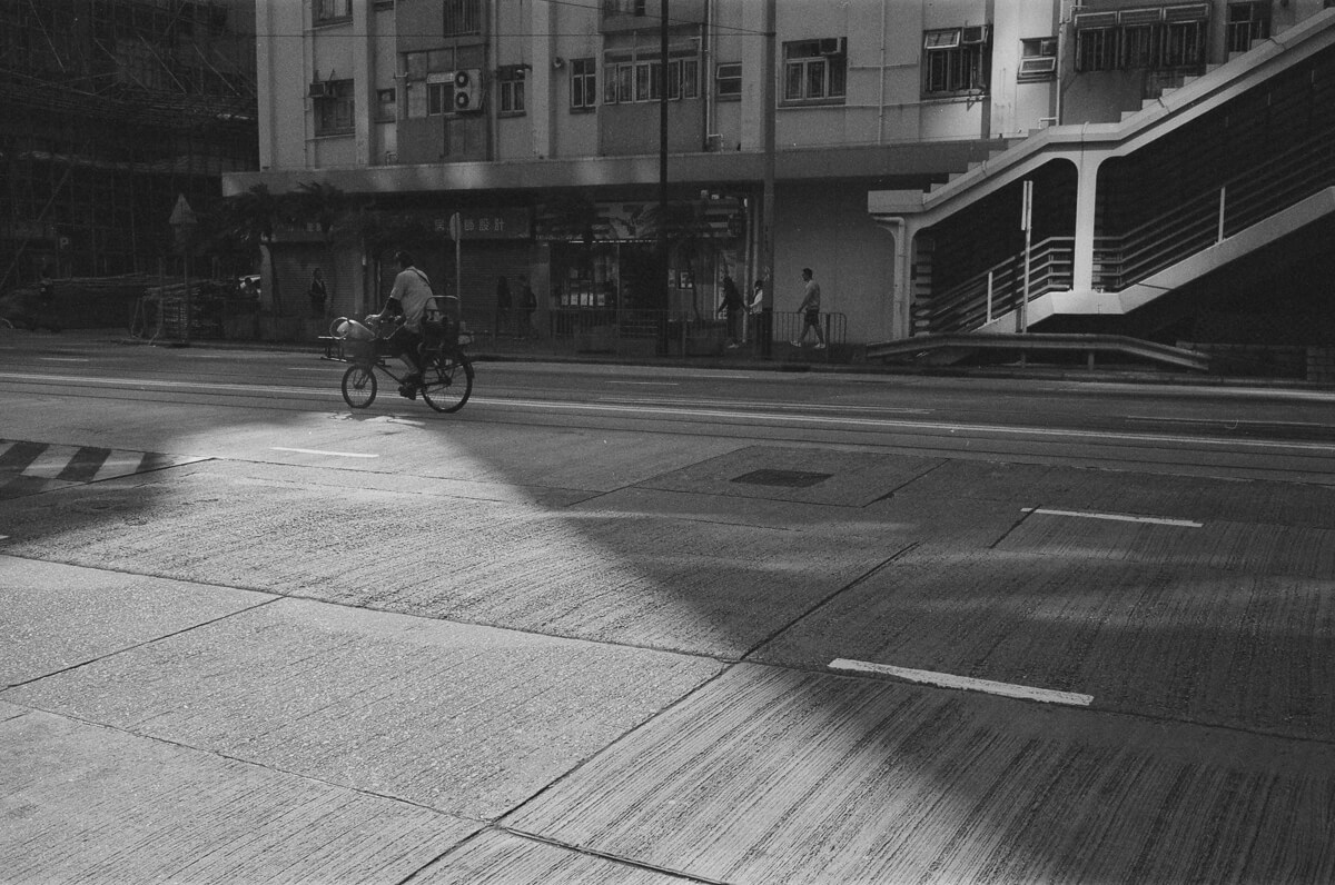 Perfect-moment-with-LPG-gas-delivery-man-cycling-into-the-right-spot--taken-in-north-point-hong-kong-shutter-alliance-photowalk-Leica-Summicron-35mm-f2-IV-Ilford-Delta-400-black-and-white-bw-monotone
