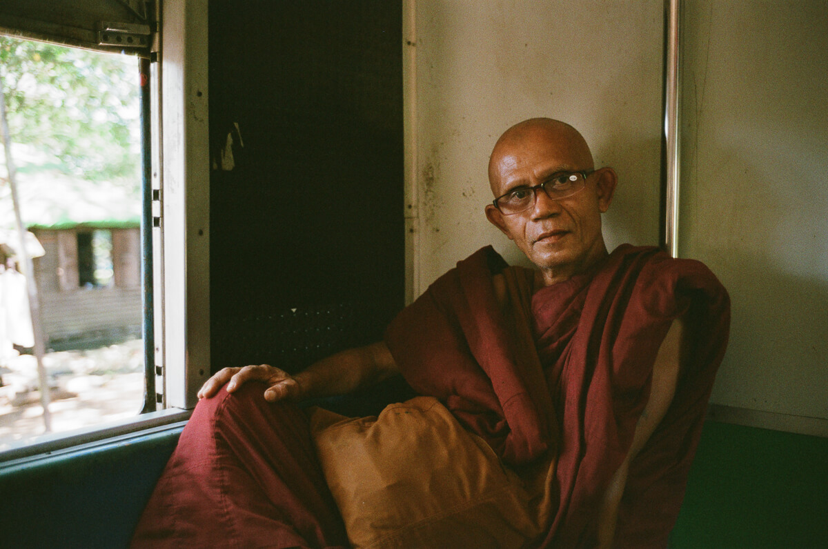 circular-train-monk-with-glasses-portrait-documentary-life-myanmar-yangon-35mm-f2-summicron-8elements-v1-leica-m2-Fuji-fujifilm-Superia-Premium-400-travel