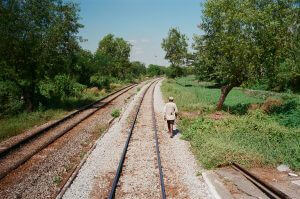 circular-train-outside-environment-green-nature-train-track-walking-portrait-documentary-life-myanmar-yangon-35mm-f2-summicron-8elements-v1-leica-m2-Fuji-fujifilm-Superia-Premium-400-travel
