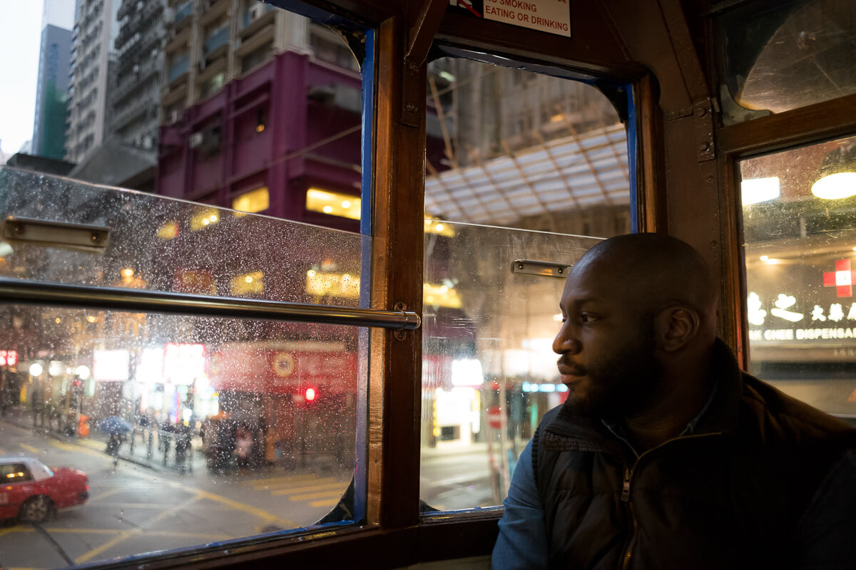 reggie-on-tram-sitting-penetrate-central-HongKong-Hong-Kong-Shutter-Alliance-Photowalk-photo-walk-hk-North-Point-Leica-m10-digital-camera-rangefinder-Elmarit-28mm-f2.8-2.8-v3-wide-angle