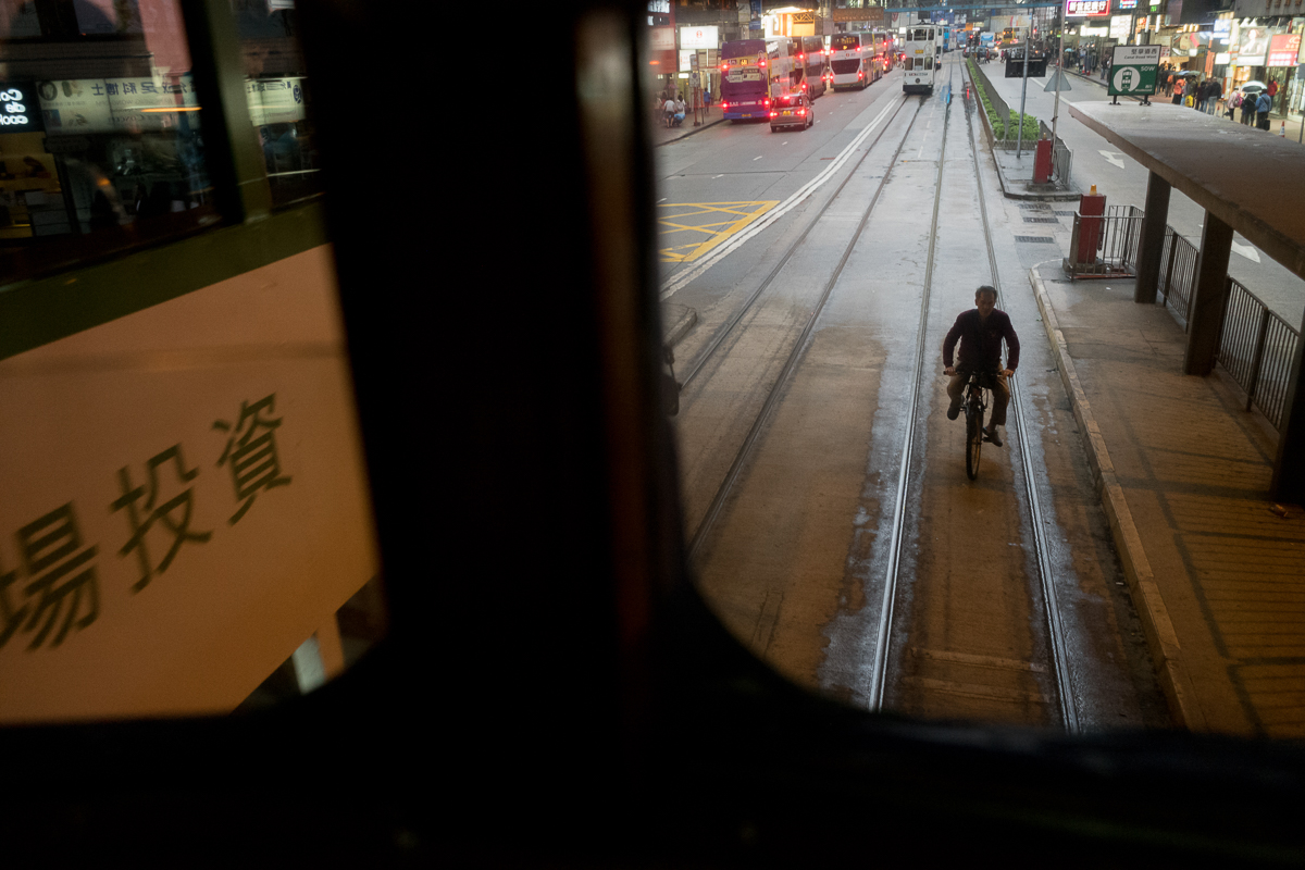 tram-local-man-riding-delivery-following-tramway-busy-crowd-Hong-Kong-Shutter-Alliance-Photowalk-photo-walk-hk-North-Point-Leica-m10-digital-camera-rangefinder-Elmarit-28mm-f2.8-2.8-v3-wide-angle