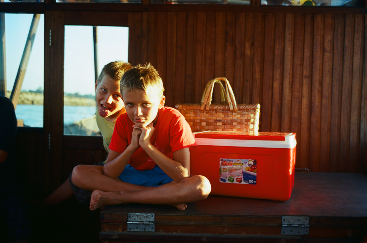 two-sons-owner-giving-me-clown-face-Boat-trip-from-Hostel-Travelling-in-bagan-myanmar-for-10-days-using-leica-camera-M2-Summicron-35mm-f2-V1-Kodak-Ektar-100