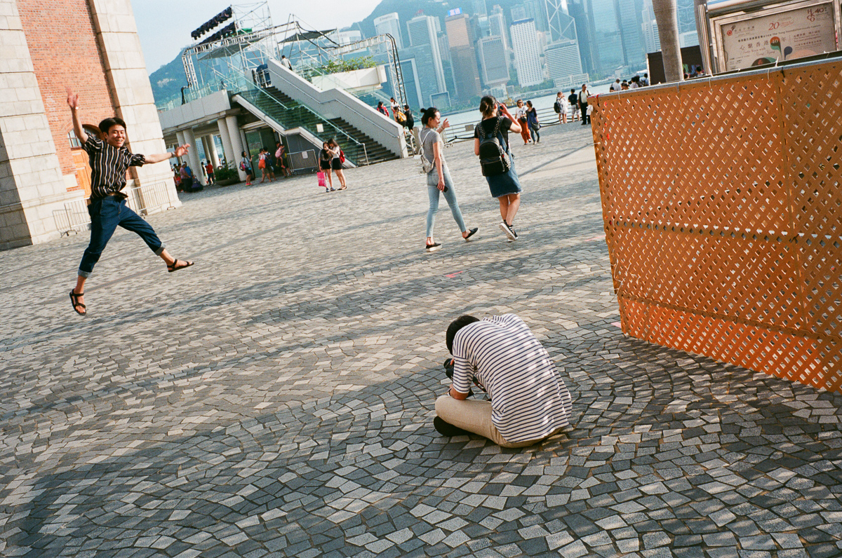 Japanese-tourist-jumping-around-Cultural-Centre-Hong-Kong-Tsim-sha-tsui-Superia-premium-400-fuji-fujifilm-film-analog-Leica-Summicron-35mm-f2-IV-7elements