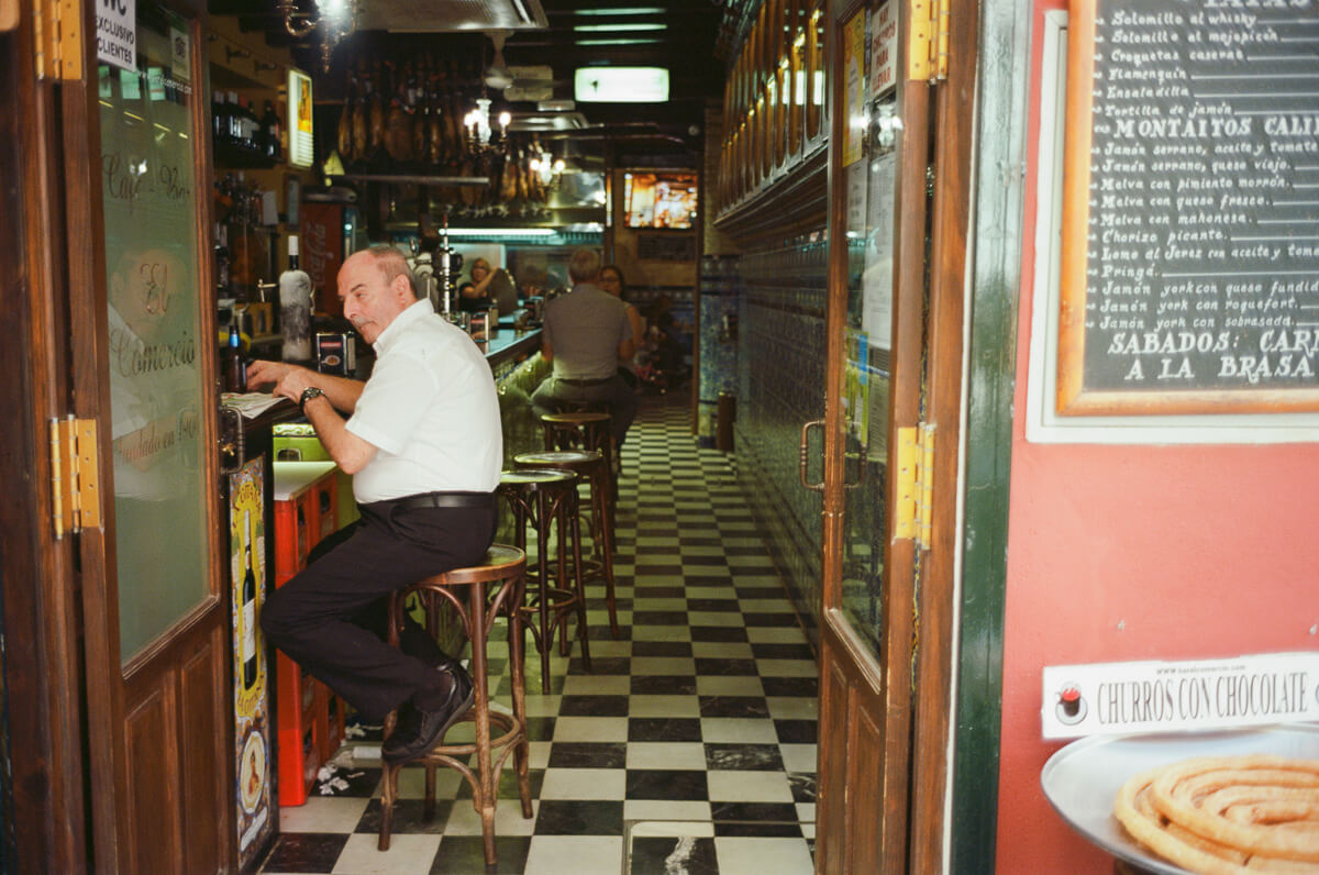 local-restaurant-man-eating-visit-Sevilla-spain-Kodak-Ektar-100-film-analog-Summicron-35mm-f2-35-v1-8elements-seville