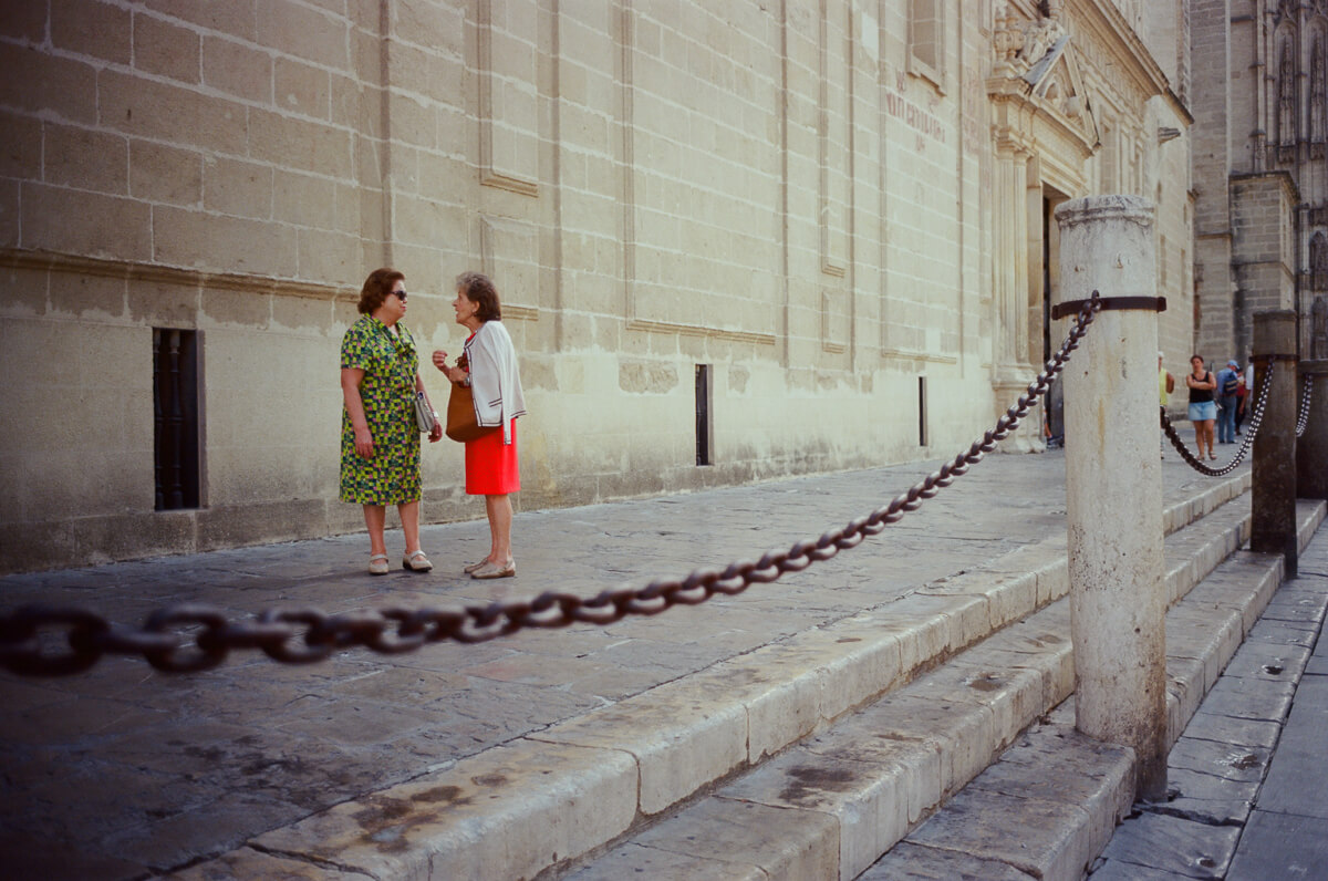 outisde-catheral-ladies-chatting-travel-blog-visit-Sevilla-spain-Kodak-Ektar-100-film-analog-Summicron-35mm-f2-35-v1-8elements-seville