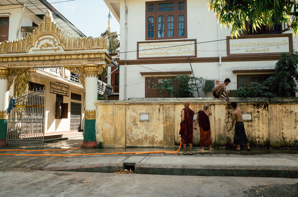 Monks-in-yangon-cleaning-up-the-wall-outside-pagoda-myanmar-street-photography