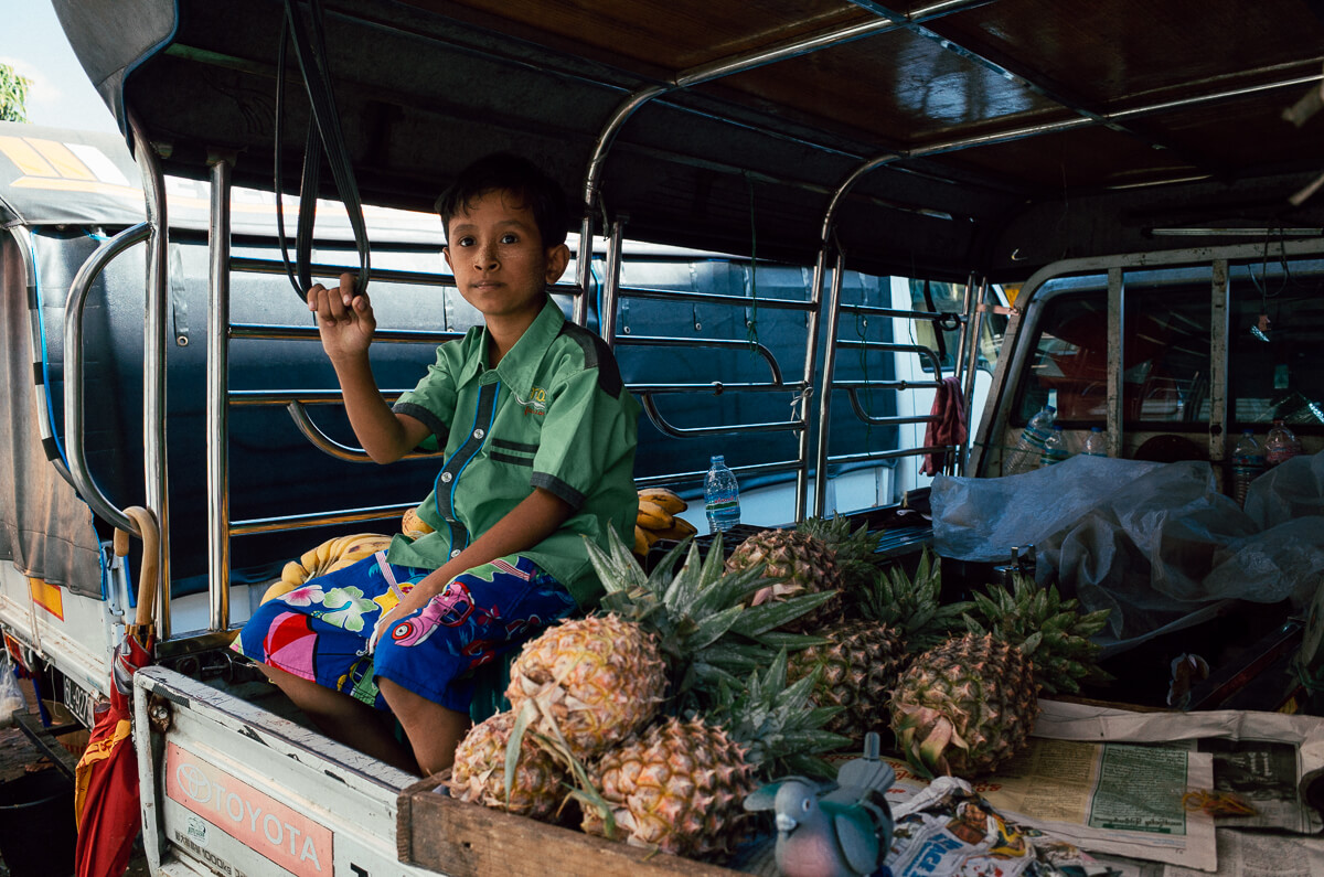 Portrait-of-pinapple-kid-in-Konzedan-Street Area-myanmar-yangon-street-photography