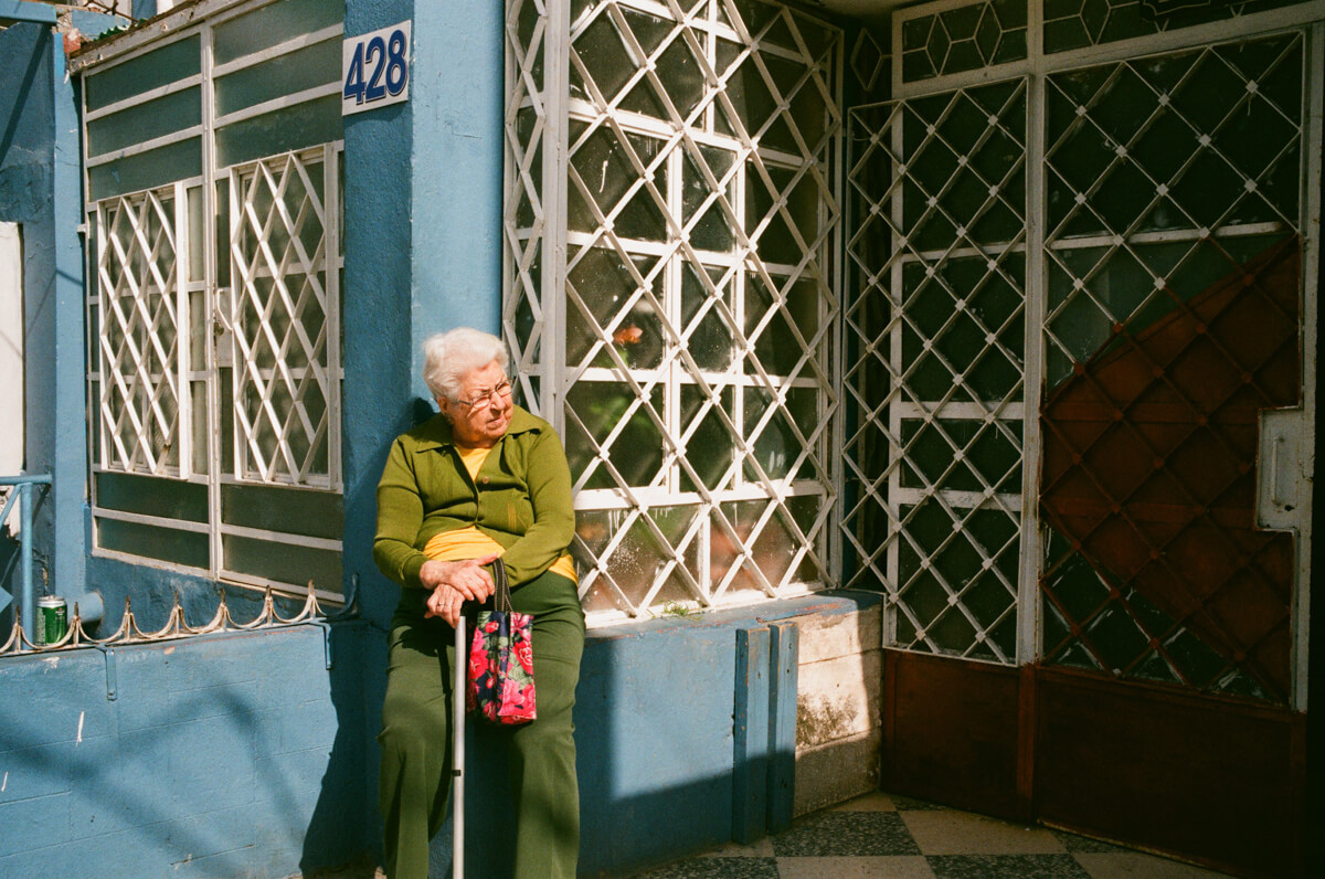 Lady-outside-hostel-sitting-waiting-for-her-husband-vivid-color-Cuba-havana-tahusa-centro-Agfa-400-Vista-Leica-Summilux-35mm-1.4-asph-fle-11663-film-photography-guide-street-travel-travel-guide-tips