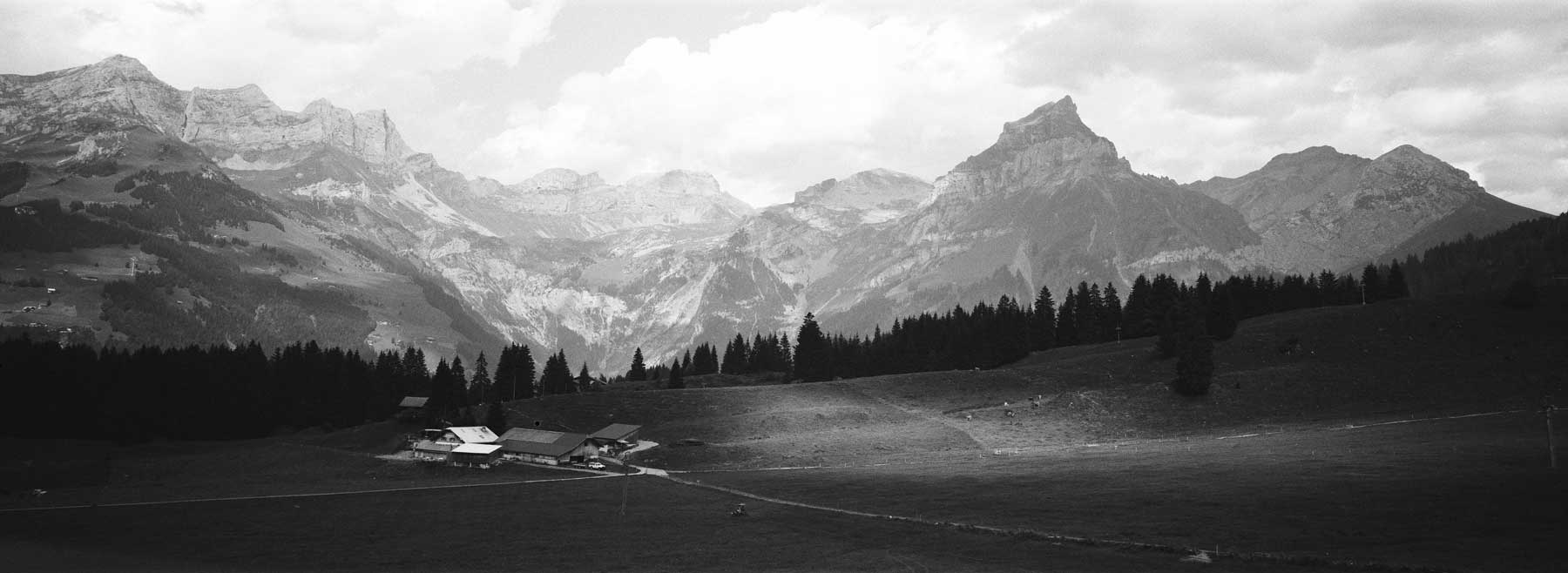 hasselblad-xpan-ii-review-hassel-rangefinder-camera-film-camera-review-photography-pano-panorama-panoramic-45mm-f4-switzerland-bw-black-and-white-film-efke-acros-100-mountains-titlis