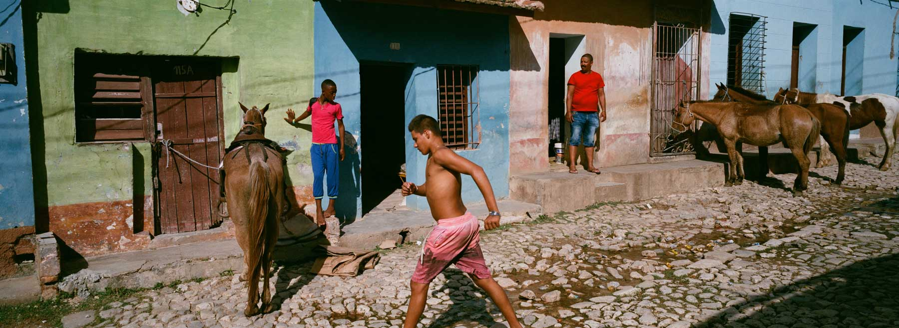 hasselblad-xpan-ii-review-hassel-rangefinder-camera-film-camera-review-photography-pano-panorama-panoramic-45mm-f4-trinidad-horse-hut-daily-life-local-people