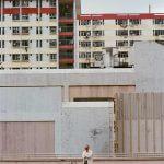 kodak-ultramax-400-iso-film-review-hk-hong-kong-housing-estate-uncle-with-sunglasses-standing-in-front-of-buildings-blocks-nikon-f100-85mm-f1.4-AFD