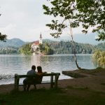 kodak-ultramax-400-iso-film-review-lake-bled-slovenia-travel-composition-tree-branches-church-summilux-35mm-f1.4-leica-infinity-lock-couple-sitting-on-bench