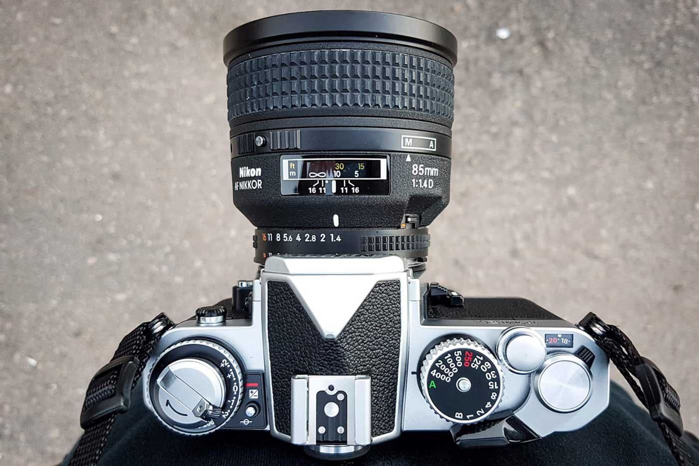 10-tips-buying-second-hand-used-pre-owned-film-camera-beginner-guide-check-detect-inspecting-working-properly-cameras-lenses-nikon-85mm-top-view