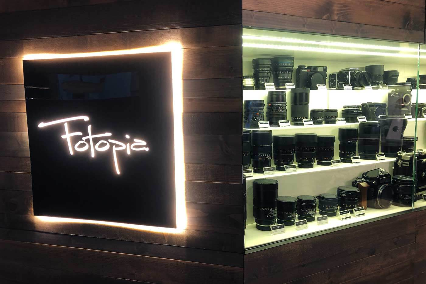 Camera-shop-shops-hong-kong-hk-location-guide-tips-purchase-consignment-second-hand-pre-owned-lenses-cameras-fotopia-display-cabinet-leica-specialist-medium-format-logo